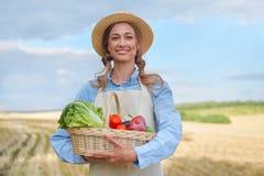 Woman farmer straw hat apron standing farmland smiling Female agronomist specialist farming agribusiness Happy positive caucasian