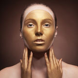 Woman with fashion art make up on brown background Royalty Free Stock Images