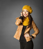 Woman Fashion Beauty Portrait, Model Girl In Autumn Season. Clothing Posing in Studio, Yellow Fall Style over gray background Stock Photos