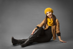 Woman Fashion Beauty Portrait, Model Girl In Autumn Season. Clothing Posing in Studio, Yellow Fall Style over gray background Royalty Free Stock Image