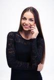 Woman in fashion black dress talking on smartphone Royalty Free Stock Photo
