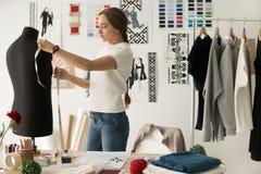 Woman Fashion Designer Measuring Mannequin In Cozy Creative Desi Stock Photo