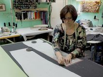 Woman fashion designer works in the Atelier royalty free stock photos