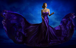 Woman Fashion Dress, Blue Art Gown Flying Waving Silk Fabric. Woman Fashion Dress, Blue Art Gown Flying Silk Fabric, Elegant Model in Waving Purple Cloth Royalty Free Stock Images