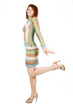 Woman in fashion dress standing on one leg Royalty Free Stock Image
