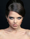 Woman fashion face make-up. Jewelry Stock Images
