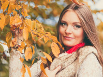 Woman fashion girl relaxing walking in autumnal park Royalty Free Stock Photo