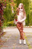 Woman fashion girl relaxing walking in autumnal park Stock Photography