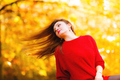 Woman fashion girl relaxing walking in autumnal park, outdoor Royalty Free Stock Image