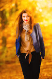 Woman fashion girl relaxing walking in autumnal park, outdoor Stock Image