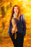 Woman fashion girl relaxing walking in autumnal park, outdoor Royalty Free Stock Photography