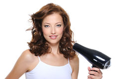 Woman with fashion hairstyle holding hairdryer Royalty Free Stock Photos