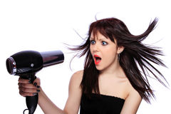 Woman with fashion hairstyle holding hairdryer Royalty Free Stock Photography
