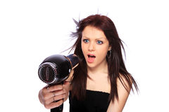 Woman with fashion hairstyle holding hairdryer Stock Photo