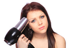 Woman with fashion hairstyle holding hairdryer Royalty Free Stock Photo