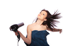 Woman with fashion hairstyle holding hairdryer Royalty Free Stock Images
