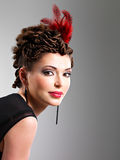 Woman with fashion hairstyle with red feather in hairs Stock Photo