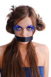Woman with fashion make-up and black ribbon. Sexy woman with fashion make-up and black ribbon on the mouth, isolate on white. may be use for BDSM concept Royalty Free Stock Photos