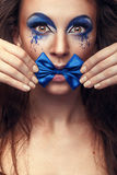 Woman with fashion make up and bow in mouth Royalty Free Stock Photos