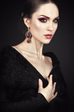 Woman with fashion makeup and accessories Stock Photos
