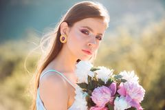 Woman with fashion makeup. flowers. face and skincare. Travel in summer. Natural beauty and spa therapy. Spring woman. Springtime and vacation. Summer girl royalty free stock image