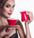 Woman with fashion makeup and tea cup Royalty Free Stock Images