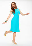 Woman fashion model in blue cocktail dress. Stock Photos