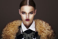 Beautiful Fashionable Strict Fashion Model in Fur Coat. Luxury Stock Images