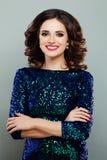 Woman Fashion Model in Glitters Dress. Smiling Woman Fashion Model in Blue Glitters Dress stock photos