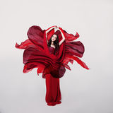 Woman Fashion Model in Red Flower Silk Dress Stock Photography