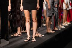 Fashion Models walk back Finale on Runway Ramp during Fashion Week. Woman Fashion Models stand Finale on Runway Ramp during Fashion Week to present New Clothing stock photo