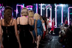 Fashion Models walk back Finale on Runway Ramp during Fashion Week. Woman Fashion Models walk back Finale on Runway Ramp during Fashion Week to present New royalty free stock images