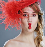 Woman fashion portrait in red vintage hat with feathers Royalty Free Stock Photos