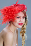 Woman fashion portrait in red vintage hat with feathers Royalty Free Stock Images