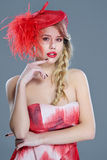 Woman fashion portrait in red vintage hat with feathers Stock Photography