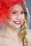 Woman fashion portrait in red vintage hat with feathers Stock Photo