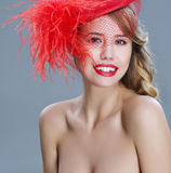 Woman fashion portrait in red vintage hat with feathers Stock Photos