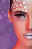Woman fashion rhinestone make up on blurry background Stock Photos