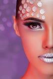 Woman fashion rhinestone make up on blurry background Stock Photos