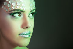 Woman with fashion rhinestone make up green tonning Royalty Free Stock Photography