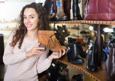 Woman at fashion shoe store Royalty Free Stock Photo