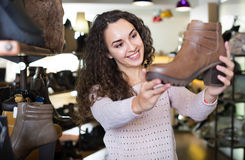 Woman at fashion shoe store Royalty Free Stock Photography