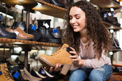 Woman at fashion shoe store Royalty Free Stock Photo