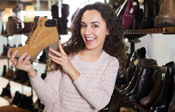 Woman at fashion shoe store Royalty Free Stock Photos