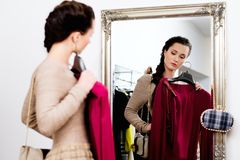 Woman in a fashion showroom Royalty Free Stock Images
