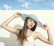 Woman with fashion spring hat Royalty Free Stock Photography