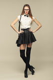 Woman is in fashion style in black mini skirt. Fashion girl Royalty Free Stock Photo