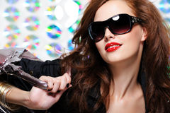 Woman with fashion sunglasses and handbag Stock Image