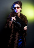 Woman with fashion sunglasses and handbag Stock Photo