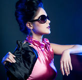 Woman with fashion sunglasses and handbag Stock Image